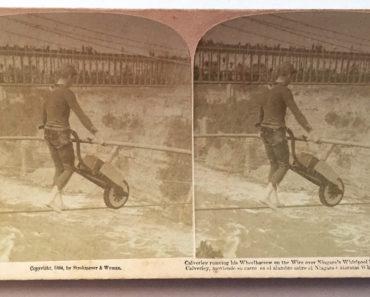 Clifford Calverley pushes a wheelbarrow across the wire.